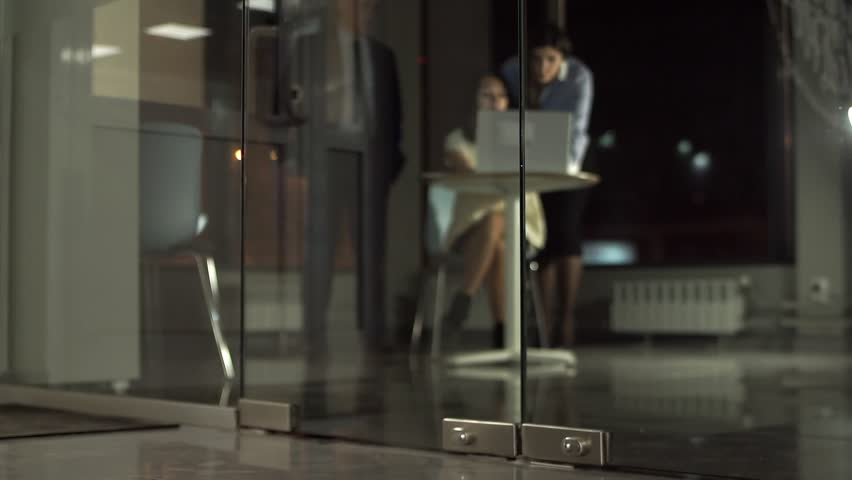Girl Manager out of the office with glass doors. | Shutterstock HD Video #1020684193