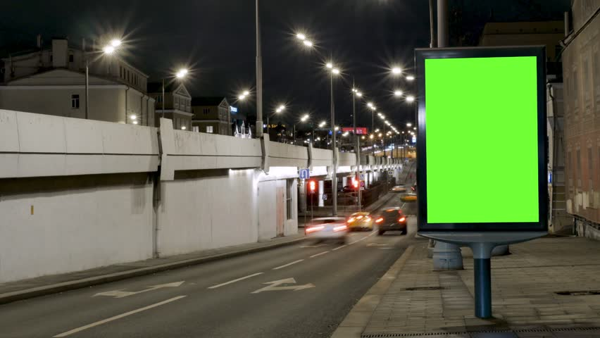 Time lapse citylight with green screen located on street pavement against driving cars in evening | Shutterstock HD Video #1020716143