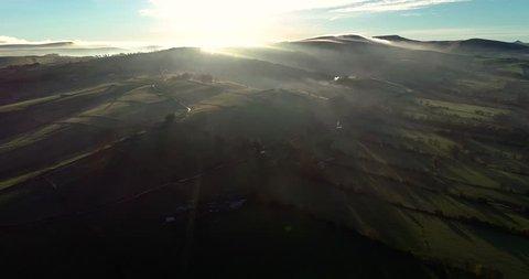 Foggy Peak District scene with wonderful Biblical dawn sunburst drone 4k tracking above fog