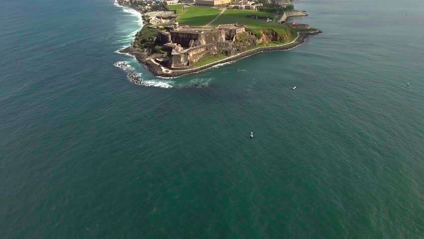 Beautiful Aerial shot coming in from ocean to El Morro in Old San Juan, PR