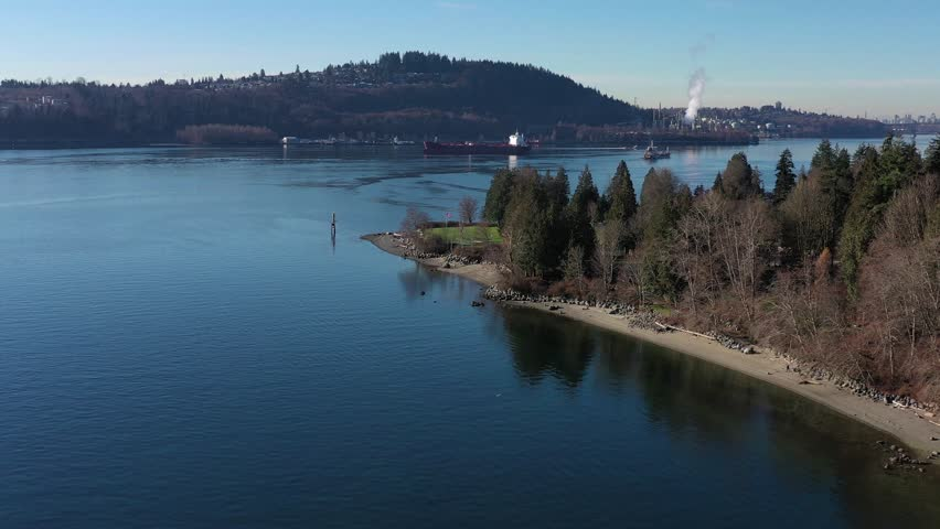 Aerial view over Burrard Inlet, ocean and island with boat and mountains in beautiful British Columbia. Canada. | Shutterstock HD Video #1020790453