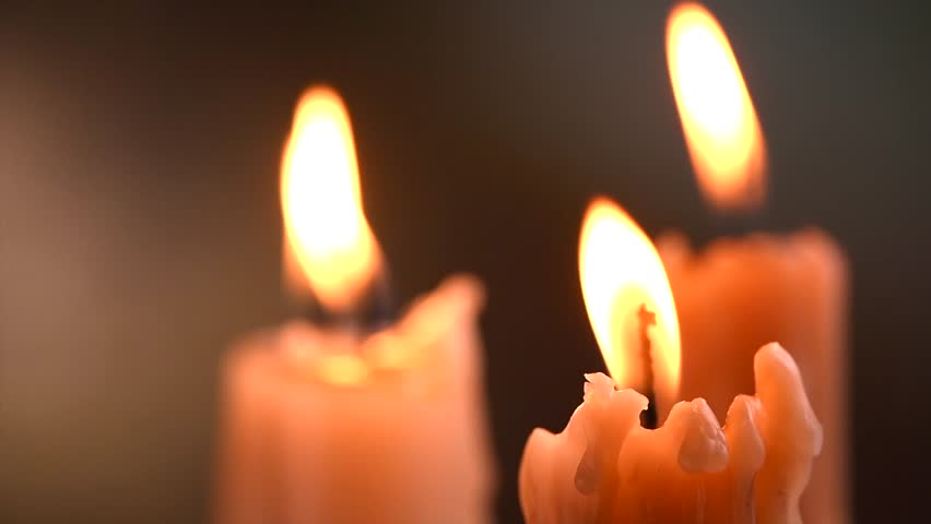 Candles flame close up on a dark background. Candle light border design. Melted Wax Candle Burning at Night. White Candles Burning in the Dark. Candlelight. Slow motion 4K UHD video | Shutterstock HD Video #1020791293