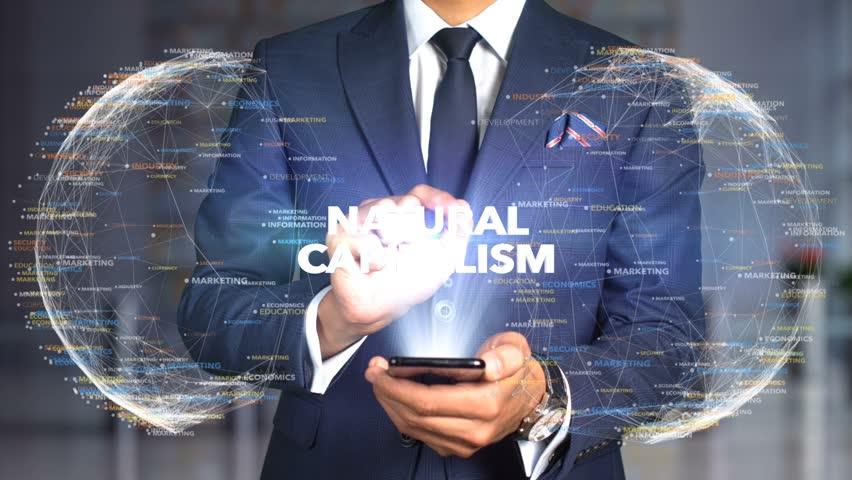 Businessman Hologram Concept Economics - Natural Capitalism | Shutterstock HD Video #1020895453