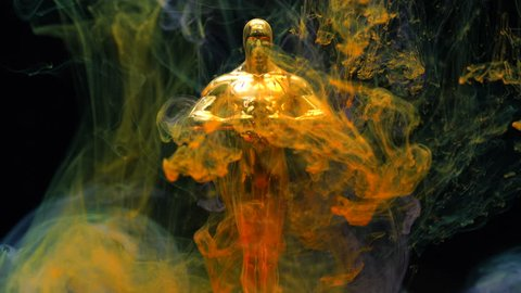 Antalya / Turkey 12.11.2018 : Short video of Oscar statue and color inks in water