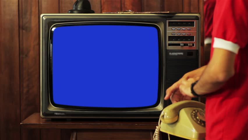"Kid Talking on Vintage Phone and Watching Old 1980s Tv with Blue Screen. Ready to Replace Blue Screen with Any Footage or Picture you Want. You Can Do it With ""Keying"" (Chroma Key) Effect. 
