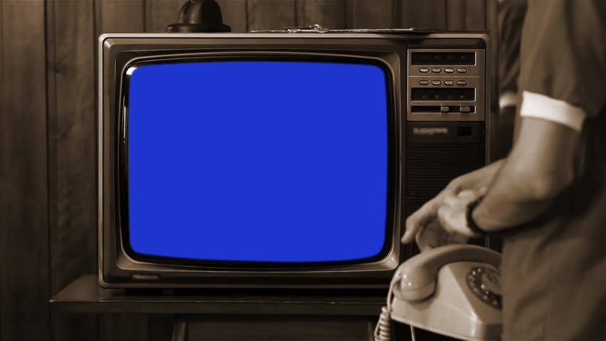 "Kid Talking on Vintage Phone and Watching Old 1980s Tv with Blue Screen. Ready to Replace Blue Screen with Any Footage or Picture you Want. You Can Do it With ""Keying"" (Chroma Key) Effect. Sepia Tone. 