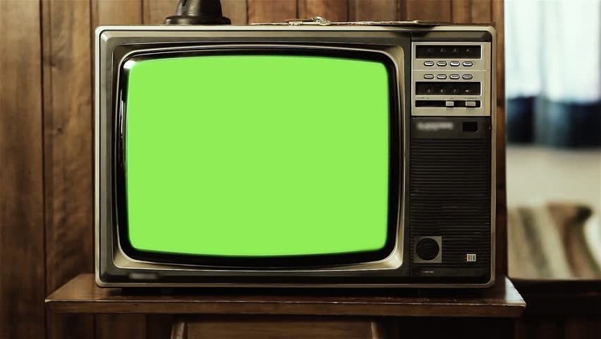 "1980s Tv with Green Screen Sepia Toned in a Room. Zoom In Slow. Ready to Replace Green Screen with any Footage or Picture you Want. You can do it with ""Keying"" (Chroma Key) effect. 
