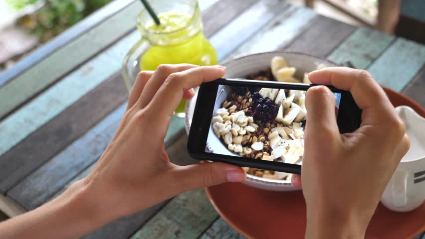 Female Hands With Phone Taking Pictures Of Food. Healthy Breakfast. #1021121443