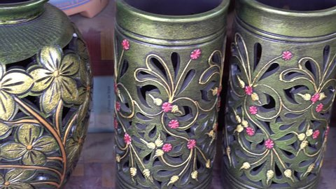 Handmade traditional craft known as 'labu sayong' normally used as gift or souvenir found in Perak, Malaysia. Clay pottery arts. Artistic clay container carving.