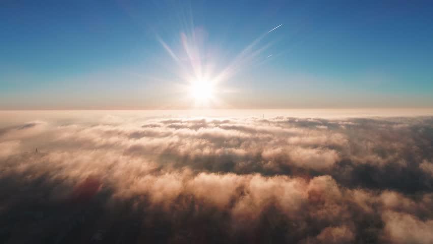 Morning flight over the city through the fog | Shutterstock HD Video #1021159483