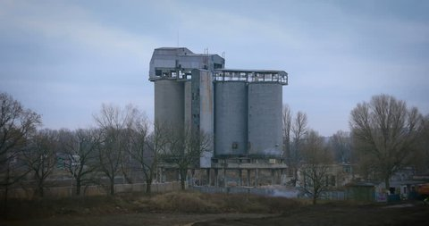 old concrete silo building demolition by an explosion