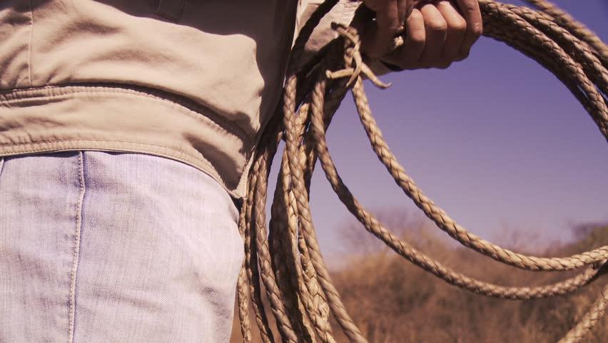 Farmer Preparing the Rope to Herd Cattle.   Shutterstock HD Video #1021240423