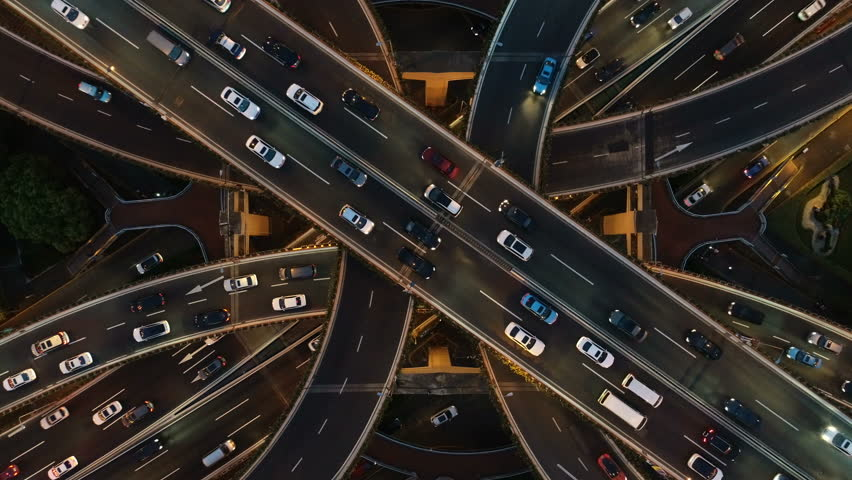 Overhead drone shot of cars driving over elevated highway and busy interchange in Shanghai, China #1021274983