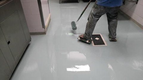Spreading self leveling epoxy with roller