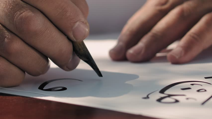 Caligraphy Art, Calligraphy Arabic Islamic Art. Calligrapher hand writes Arabic words outdoor.4K footage.