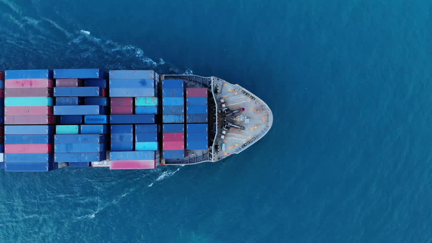 Aerial top view of cargo container ship vessel import export container in the ocean. | Shutterstock HD Video #1021382983