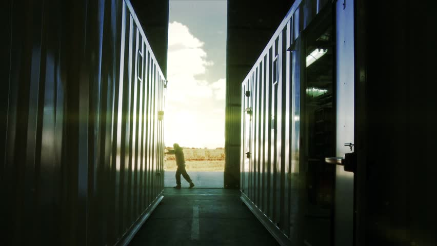 Man Opening Door of a Container Warehouse at Sunset. | Shutterstock HD Video #1021422193