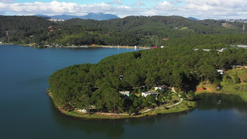 Amazing, beautiful panorama of Tuyen Lam lake of Dalat city, fresh air, group of villa among forest, impression shape of hill and mountain, lake alternate jungle make wonderful countryside for travel  | Shutterstock HD Video #1021472323