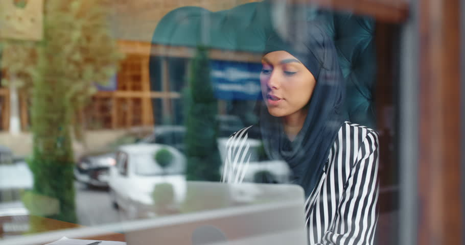 Female muslim hr manager at job interview, talking to a candidate and smiling, - modern muslim, human resources concept 4k | Shutterstock HD Video #1021483423