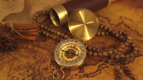 old world map with vintage compass and spyglass telescope