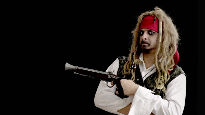 Cheerful man in fancy dress pirate smiling on black background | Shutterstock HD Video #1021522363