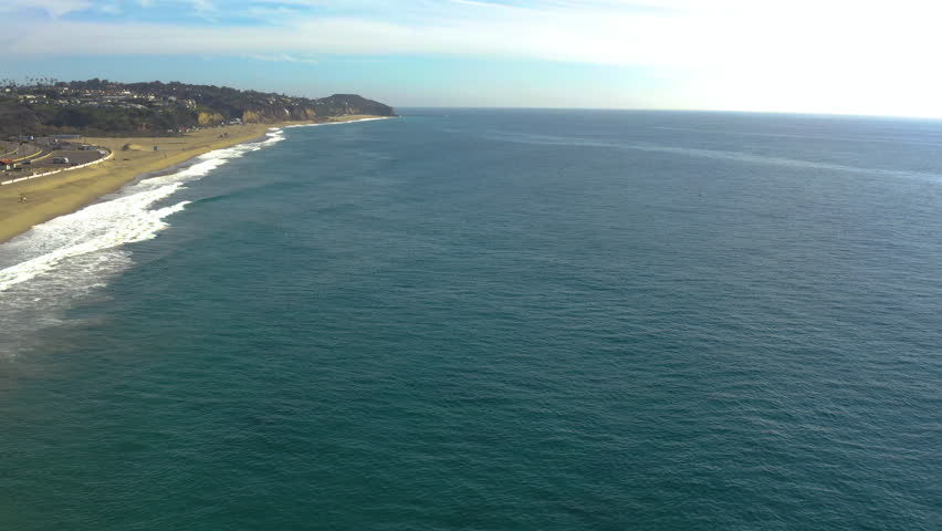 Aerial Drone Footage Ocean Coastline Pan Up While Descending | Shutterstock HD Video #1021530583