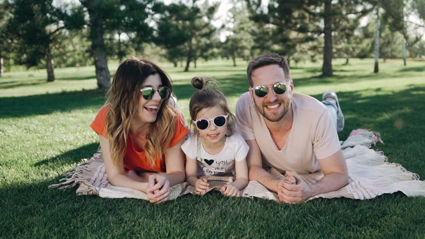 Quality family time. Picnick time. Young happy family is enjying summer day. | Shutterstock HD Video #1021570633