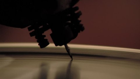 Close-Up of a Record Needle Dropping Onto a Record.