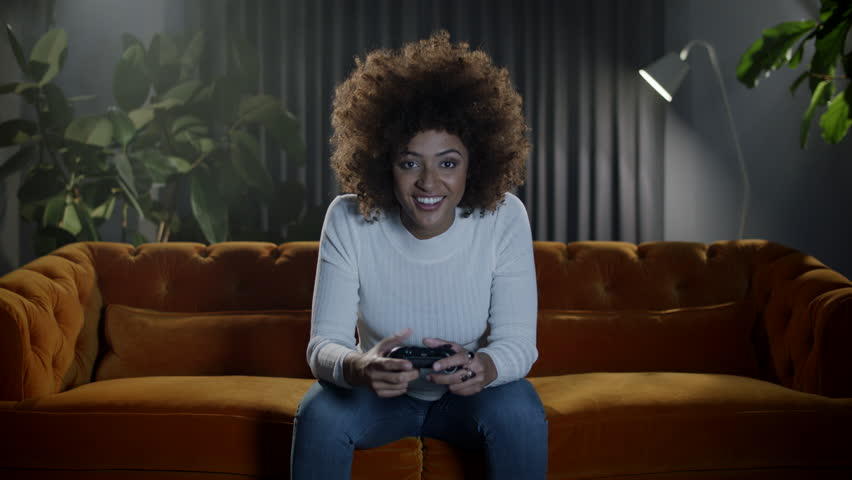 Girl gamer playing video games at home. | Shutterstock HD Video #1021600603