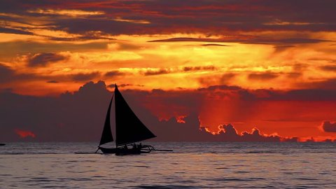 Sail Boat Sails By at Sunset Close Up Boracay Philippines