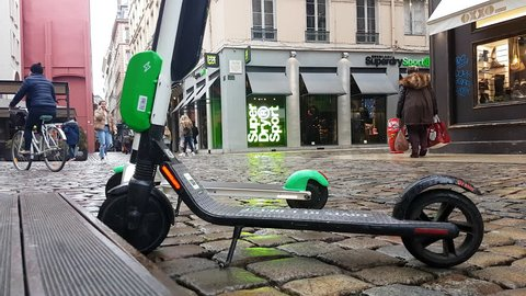 Lyon, France - January 4, 2019: Two Lime-S Electric Rental Scooter Parked In The Rue Merciere Street In Lyon, France, Europe - 4K Resolution