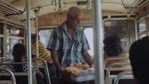 Snack seller on Sri Lankan bus. Sri Lanka february 2016