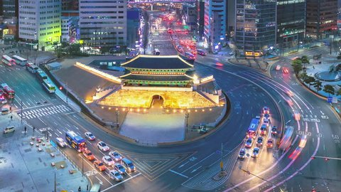 Traffic at old fortress Namdaemun gate in Seoul South Korea.