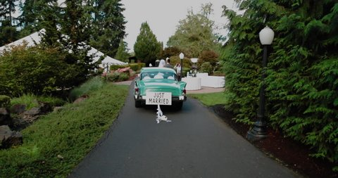 Old time Car with Just Married Sign Cans