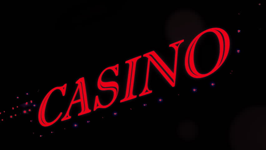 Red casino sign with flashing lights at entrance to casino glows in the dark. | Shutterstock HD Video #1021911043