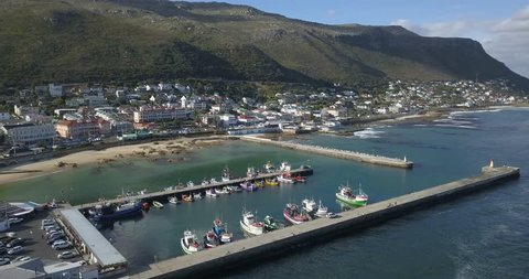4K summer day aerial drone footage of spectacular Kalk Bay harbour, boats, lagoon with beach. Kalk Bay is Cape Town residential suburb on False Bay of Cape Peninsula, Western Cape, South Africa