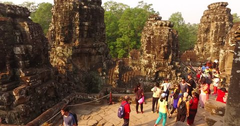 SIEM REAP, CAMBODIA - DECEMBER 22,2018: Tourists in Bayon, Angkor Thom, Aerial view of Cambodia landmark Angkor Wat of popular tourist attraction ancient temple.