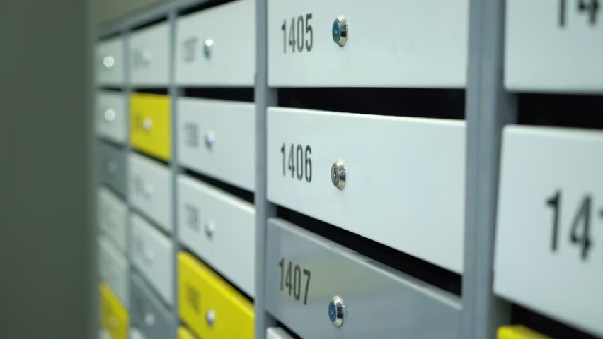 Mailbox in the entrance hall of an apartment building. Gray and yellow | Shutterstock HD Video #1022001553