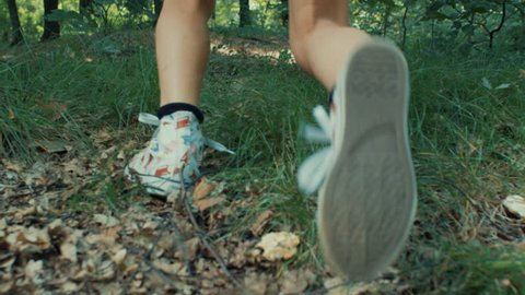 A little girl running in the wood, shot with red epic in slow motion
