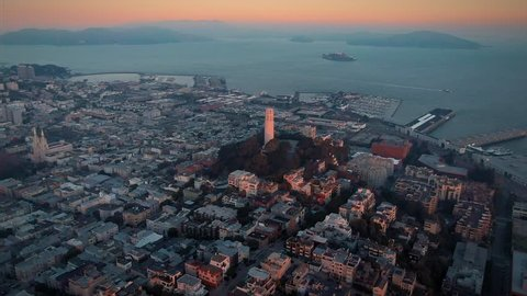 Aerial: Coit Tower, Telegraph Hill and the San Francisco city skyline at sunrise