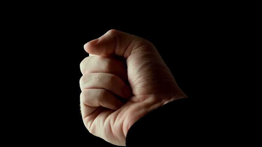 Male hand clenched infist in rays of light isolated on black background. Fingers slowly open themselves and show empty palm, then clenched back into fist. Presentation concept, slow motion video.   Shutterstock HD Video #1022100043