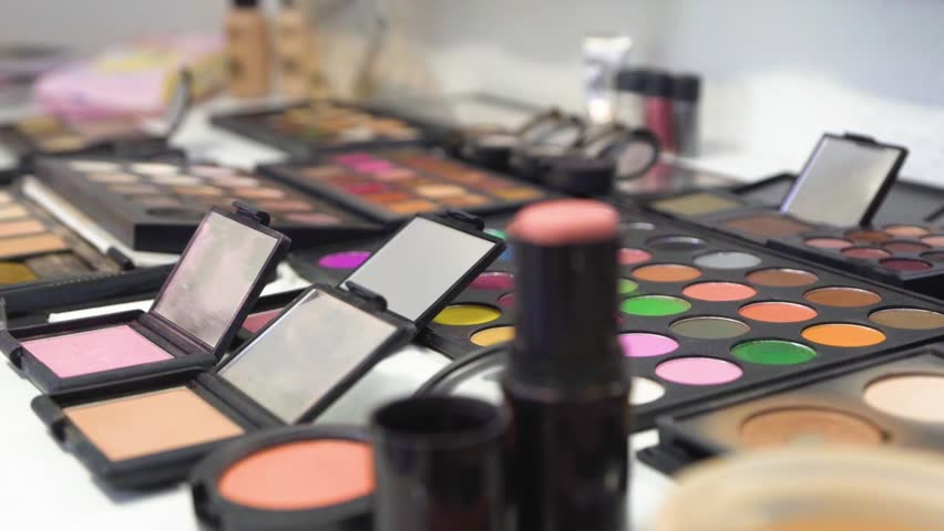 Pan across tins and pallets of Makeup. | Shutterstock HD Video #1022106343
