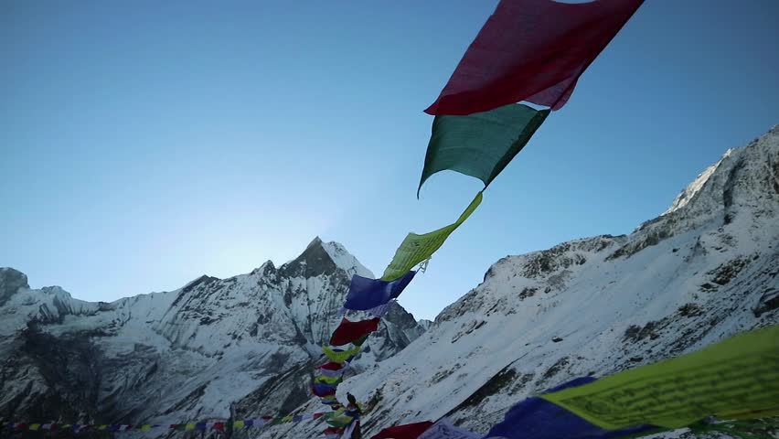 Prayer flags at annapurna base camp with fishtail as a background | Shutterstock HD Video #1022133253