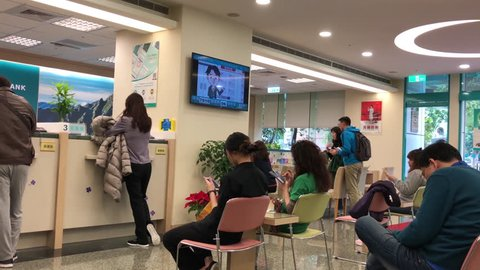 Taipei, Taiwan - January 04, 2019 : Motion of people at service counter talking to the teller inside Bank with 4k resolution