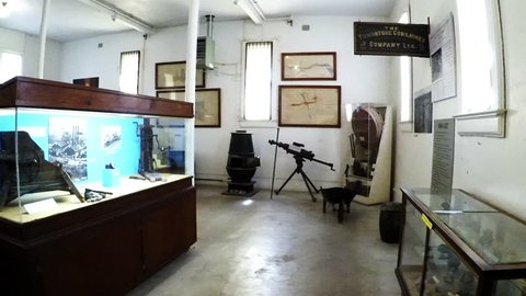 Tombstone, AZ / USA - August 1, 2018: Point of view walking through exhibits at a Courthouse museum. Cliop reveals old vintage and antique relics from historic past of small Old West town.