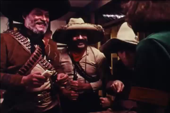 CIRCA 1970s - Sped-up film shows cooks preparing a large order at a Mexican fast food restaurant. #1022226463