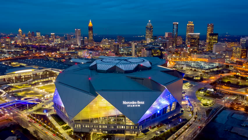Atlanta Aerial v485 Dusk to night hyperlapse rotating around Mercedes-Benz Stadium and back at dusk with blue lights 12/18