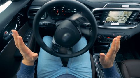 Stirring wheel is revolving without being moved by the driver. Self-driving steering wheel of an autonomous autopilot driverless car.