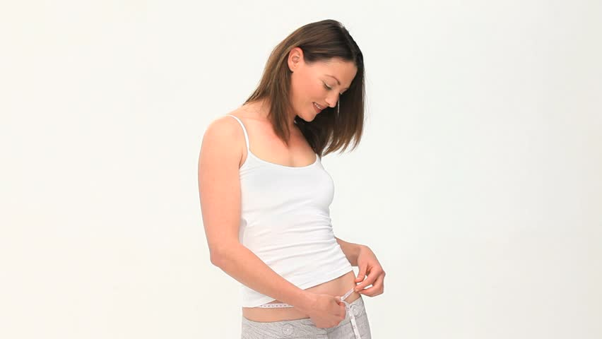 Woman excited by her waistline