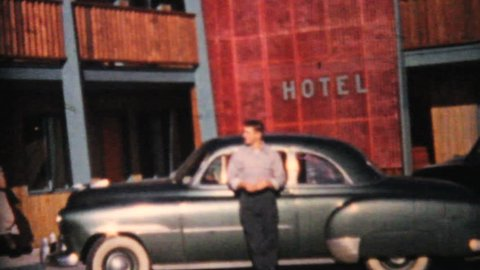 WALLA WALLA, WASHINGTON, 1964: A proud young man shows off his beautiful new car in front of a hotel in 1964.